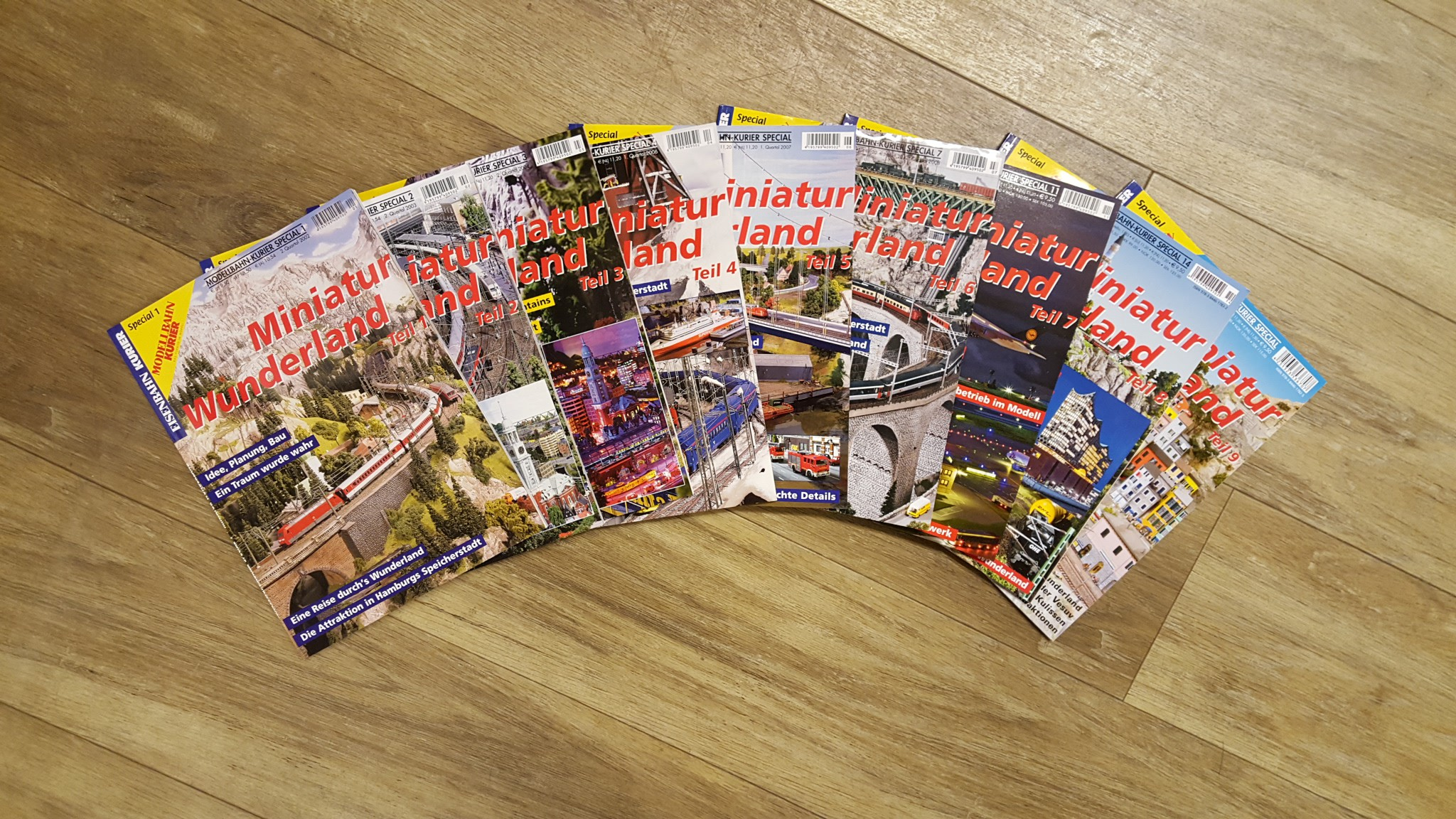 "All 9 Eisenbahn-Kurier special magazines ""Miniatur Wunderland"",including one collective folder"